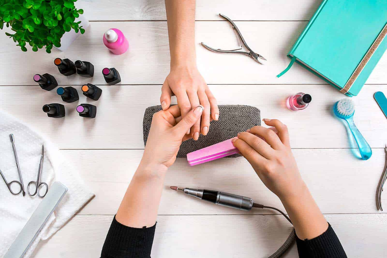women working to attract more customers to nail salon