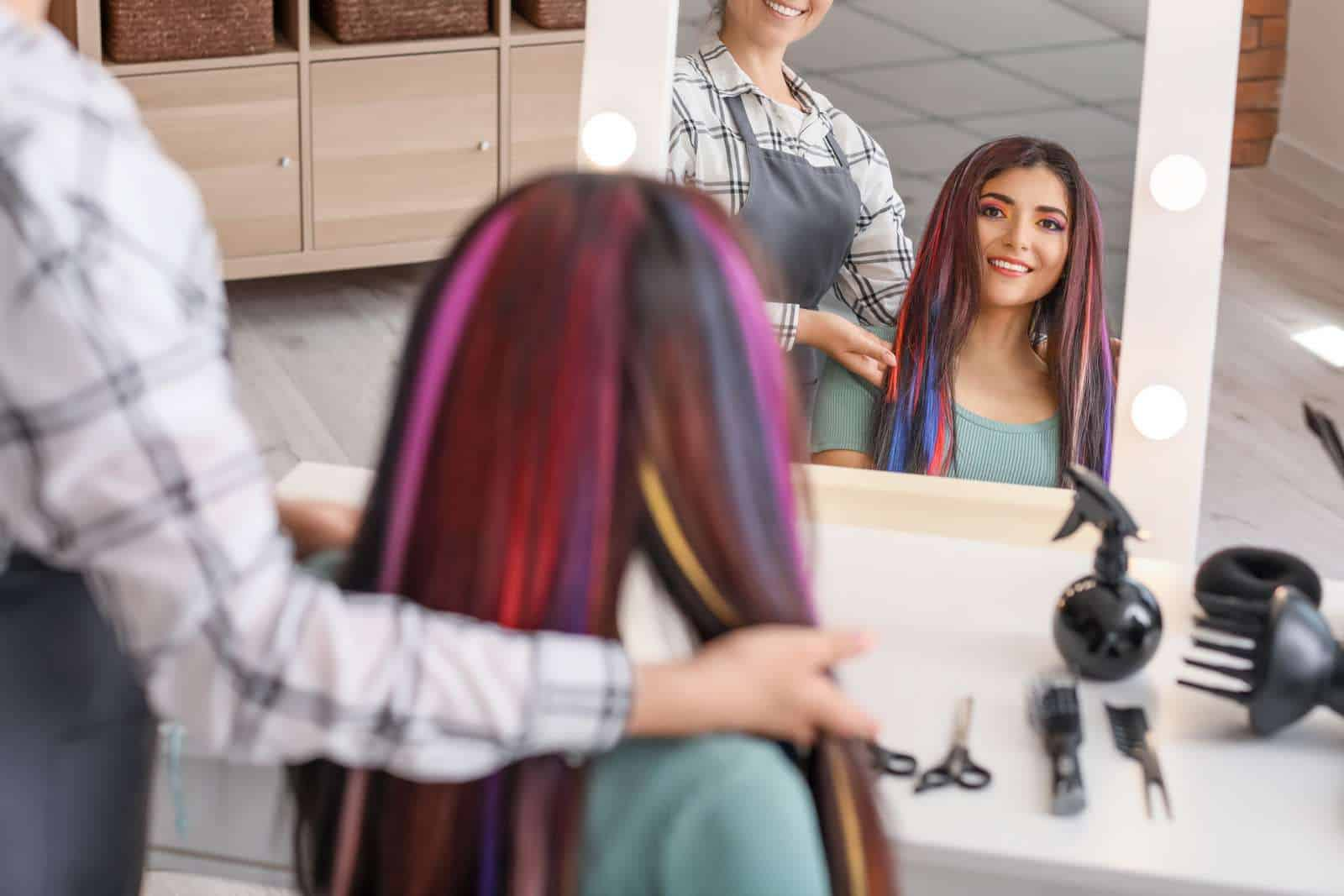 Hairdresser working with young woman in beauty salon